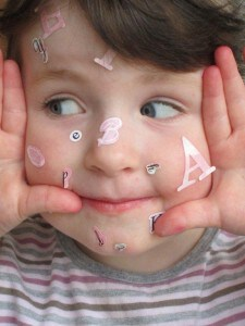 child's face with letters