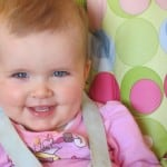 baby smiling in high chair
