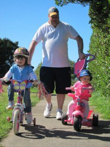 girls going for bike ride with dad