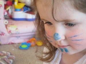 child with rabbit face painting