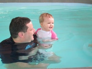 dad and baby swimming