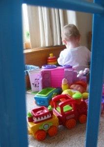 baby girl playing among toys
