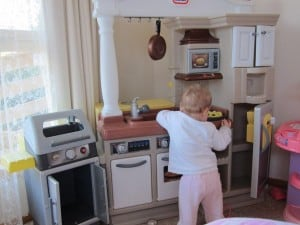 Girl in children's kitchen