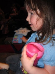 Girl at Dora the Explorer concert with her Tommee Tippee discovera cup