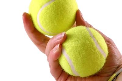 tennis balls in hand