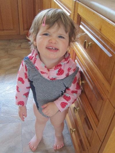 Toddler playing dress ups
